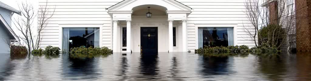 Dramatic image of flooded home outside front view