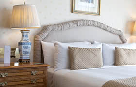 hotel bed and side table