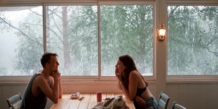 Couple at table - raining against windows
