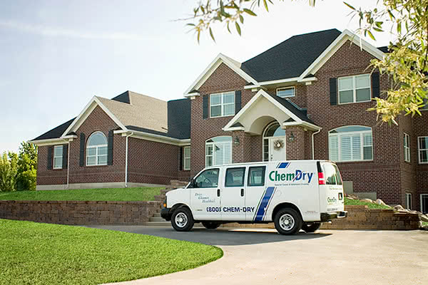 photo of a Chem-Dry franchise van providing carpet cleaning services to a residence